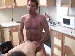 Daddy fucks his boy in kitchen