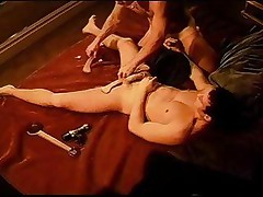 CBT hawt young muscle stud's ball sack clamped off from his cock betwixt 2 pieces of clamped wood.